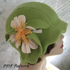 Vintage 1930s Style Flapper Hat/Helmet Pattern With Flower Trim- Instant Download Very easy to make! Make the hats for resale  Given in 2 sizes to fit most/all. Make this great hat without all usual drudge of hat construction. If you can sew a straight seam and read insturctions you can make this hat!! The pattern pieces are fulled sized- no need for graphing. Pattern includes templates for making the flower pictured. PLease Note: The chenille embroidery floral trim in picture #3 was cut…