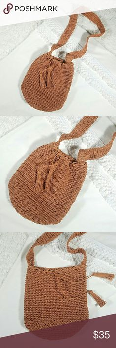 J.Crew Straw Bucket Bag Crossbody Boho Festival J.Crew burnt orange woven straw crossbody bucket bag. Chic tassels closure. Perfect for the beach and festival season!  ??Pre-owned condition with light signs of wear. Please note that woven straw is fairly lightweight and would be best for carrying lighter items. Heavy items may cause damage.  ??Strap Drop 23"