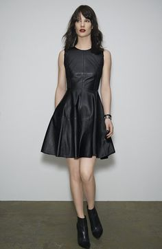 another LBLD (little black leather dress). Feminine fit and flare with edgy leather. Need.