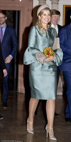 Queen Maxima at the reception at the City Hall during their visit in Leipzig clutching some flowers