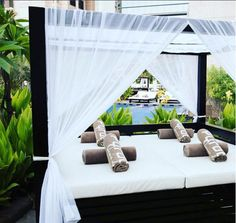 Sit back and relax on a private poolside daybed at Conrad Dubai.