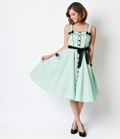 Martie in mint? Sounds delicious, darling. A vibrant mint green retro dress from Hell Bunny, Martie is a savory swing to...Price - $92.00-uaOC71rI