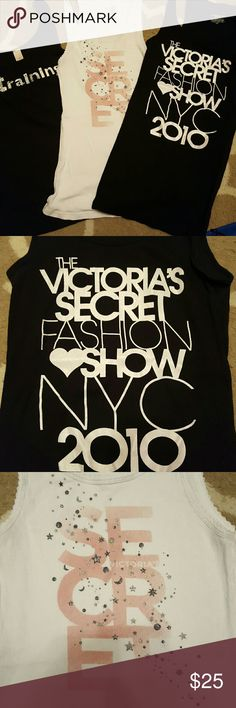 """Lot of 3 Victoria's Secret Tanks!!! There are 3 Tanks that are perfect to wear to show some BLING off or to wear to the gym! The white and the black fashion show are both mediums and in very good condition. The 3rd is a small. The front says """"In training"""" and has a bedazzled look. The back is shown in the 4th pic and has a VS. This one is in good condition. No holes or stains on any of them. Victoria's Secret Tops Tank Tops"""