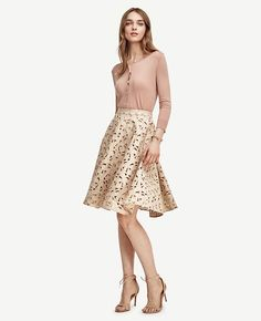 """We chose a full-skirted silhouette to showcase this feminine charmer, flaunting exquisite floral cutouts in summer's prettiest palette. Keep the rest of the look simple with neutral heels and refined accessories - and let the skirt be the star. Hidden side zipper with snap closure. Lined. 26"""" skirt length; 22"""" lining length."""