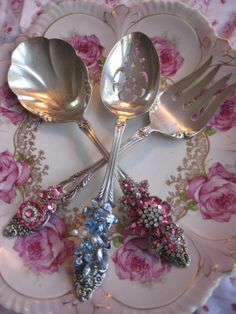 Jeweled serving fork and spoons made from vintage costume pieces. Epoxy glue works well for this craft!