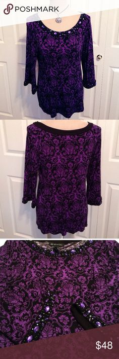 """INC Petite, Crystal Beaded Neckline & Cuffs Tunic INC Petite, Violet Purple & Black Damask Print Tunic Top, Embellished with Crystals & Beads. Scoop Neckline is Bordered with Layered Crystals & Beads with Matching Mini Bell Cuff Borders. Has a Flattering & Contouring Stretch Band Etched Below the Chest & Across the Back. An Easy Pullover Style, with Comfortable & Stretchable Fabric made of Soft 95% Rayon & 5% Spandex. Chest 36"""", Waist 32"""" - 36"""" & is 24.5"""" Long. Looks Amazing with Black…"""