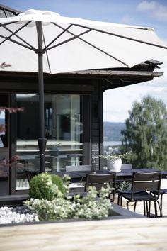 Terrace / wood deck at a serene Norwegian home on a hill. Nina Holst.