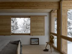 Rothaus | Jonathan Tuckey Design, Andermatt, Switzerland. The engineered larch timber-frame structure and Larch joinery. The walls finished in a natural white plaster.