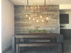 Reclaimed wood accent wall. Wood from RECwood Planks in Big Sky Grey