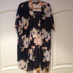 Floral Kimono Floral tunic only worn once. One size fits all, very flowy! No marks or pulls. Great for regular use or as a bikini coverup  Tops Tunics