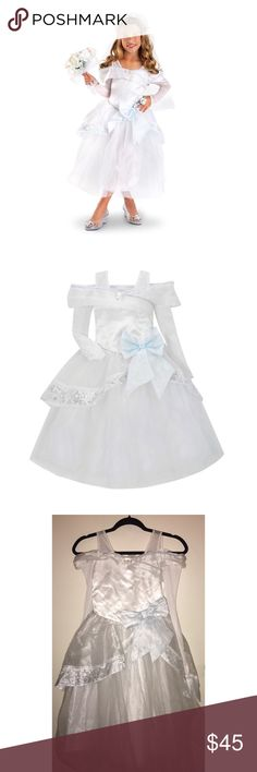 Disney Store Cinderella Wedding Dress Pre•loved Disney Store Cinderella Wedding Dress  Size 7/8  multifaceted Cinderella jewel Off the shoulders taffeta band with silver and white piping at top of shoulderline and at basque waistline Long sheer sleeves with asymmetric wrist and three-button accents White polka dots on bodice Satin underdress for comfort Faint blue bow at top of asymmetrical taffeta peplum skirt featuring silver glitter princess designs at the hem  EUC (Keep in mind item has…