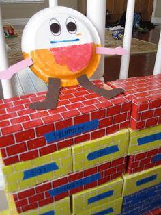 Toddler Approved!: Nursery Rhyme Wall Humpty Dumpty words on blocks to show sentences are made of words.