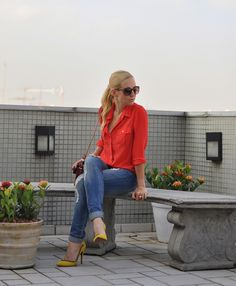 bright sheer blouse + loose fitting skinny jeans