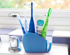 A great sized container for all sized toothbrushes including electric! Wilson the Whale is here to store multiple bathroom items, adding a BIG SPLASH of fun to the tooth brushing routine! Kids will have a whale of a time with Wilson. Toothbrush And Toothpaste Holder, Kids Toothpaste, Baby Toothbrush, Childrens Bathroom, Bathroom Kids, Kid Bathrooms, Bathroom Storage, Modern Bathroom, Whale Bathroom