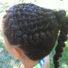 Two stranded twisted weave in a dutch braid to a two stand side pony -side view