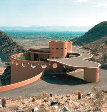 Norman Lykes House in Phoenix, Arizona, 1959.   This is Wright's last residential design built by the original client. Wright died before finishing the drawings and the design was finished by Taliesin Fellow John Rattenbury. The house, like many later Wright works, is a circular plan.    www.franklloydwright.org