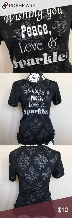 """Peace Love & Sparkles tee 60% cotton 40% poly slub material  Great condition  Silver screen print design with bling reads """"Wishing you Peace, love & Sparkles"""" Very lightweight and slightly more see through than other slub tees. I always wore a cami (or long sleeve tee during the cooler months) underneath.  Size medium but runs small. Tops Tees - Short Sleeve"""