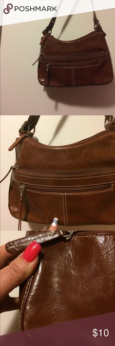 Women's  Aurielle brown Purse Women's Purse brown leather. It has 6 zippers on it. It has a little pen make on the back which is in the pics Aurielle Bags Shoulder Bags