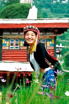Smiling Jiarong Tibetan young woman wearing traditional headdress in Gyarong Beauty Valley,Danba County,Garz� Tibetan Autonomous Prefecture,Sichuan Province,China - Royalty Free Images, Photos and Stock Photography :: Inmagine