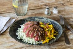 A mix of balsamic vinegar and serrano pepper creates a sweet, spicy, and tangy steak marinade. For a hit of brightness, we've paired juicy mango with red onion and lime for subtly sweet side slaw. Cilantro-lime rice is the perfect base to soak up all those flavors!