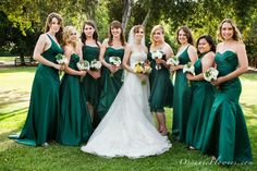 Different Styles of Bridesmaid Dresses but in the Same Emerald Green Color