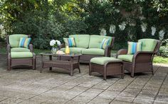 This 6-piece resin wicker Patio Furniture conversation set with cushions comes with a loveseat, 2 lounge chairs, 2 ottomans, a coffee table, and four toss pillows.  The coffee table has a tempered smoked glass inset top and a shelf for storage.  This resin wicker set is hand-woven to perfection and that attributes to its beauty.