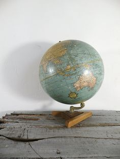 I am such a sucker for vintage globes.  Eventually, I want to display a cool collection of globes possibly in a home library.