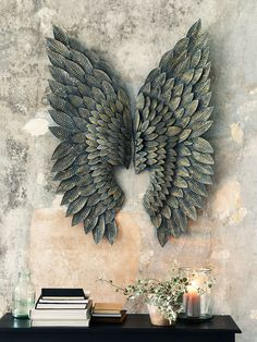 Finely crafted from golden brass, each of our Gilt Angel Wings feature individually embossed feathers with a hand painted greywash finish. This large striking pair will instantly transform your wall space; the brass details catch the light from around the room and make a stunning alternative to traditional wall art.