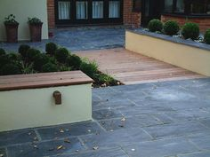 Mark Langford Garden Design. Slate paving, rendered beds, timber topped bench, box ball grid, deck runway, deck lighting, garden lighting. Southampton, Portsmouth, Winchester, New Forest, Hampshire.
