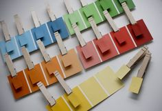 Colour swabs from paint section of hardware store and pegs...easy...effective..