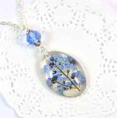 Forget me not resin Necklace with real flowers by PommeDeNeige