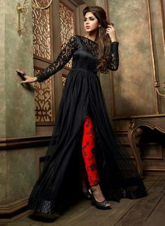 Create a smoldering impact by this black net and georgette designer suit. The lovely lace and print work a substantial feature of this attire. Comes with matching bottom and dupatta. (Slight variation...