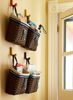 Baskets on hooks...for the shampoo and conditioner, bath gels, razors, shaving creams, mirrors, etc