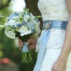 Blue Wedding Flowers back to results popular searches Email Print Kristin's blue and white blooms included ivory ranunculuses and peonies. Bouquet Bleu, Bridal Bouquet Blue, Blue Wedding Flowers, Blue Bridal, Bride Bouquets, Flower Bouquet Wedding, Blue Flowers, Peonies Bouquet, Blue Hydrangea Bouquet