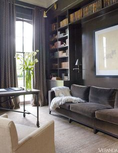Sofa, Christian Liaigre, in Rogers & Goffigon velvet. Desk, Restoration Hardware. Sconces, R. Jesse Lighting. Curtains in Zimmer + Rohde wool.