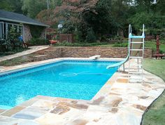 custom-stone-swimming-pool-slide by ARNOLD Masonry and Landscape, via Flickr