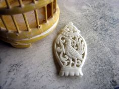 The Birdcage Vintage Style Carved Bone Pendant 55mm by Indounik, $17.00 Features a Balinese cockerel.