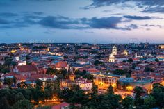 Vilnius, Lithuania. Historic Center Cityscape After Sunset. Old by Grigory_bruev. Vilnius, Lithuania. Historic Center Cityscape At Blue Hour After Sunset. Old Town Under Evening Dusk Sky. Travel Pano...