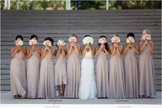 A photo with everyone giving their best bouquet-face. | 42 Impossibly Fun Wedding Photo Ideas You'll Want To Steal