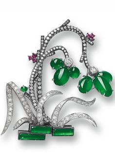 Jadeite, Ruby and Diamond 'Orchid' Brooch Designed as a pot of orchid flowers, set with seven jadeite cabochons of translucent emerald green colour and three translucent jadeite plaques of lighter tone, embellished by circular-cut rubies and diamonds together weighing approximately 3.00 carats, mounted in 18 karat white and blackened gold.