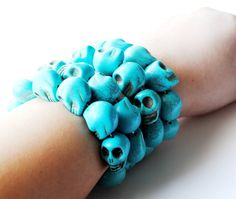 4 Bracelets, stacked, and I want them!  I love this color... it's so southwestern. <3