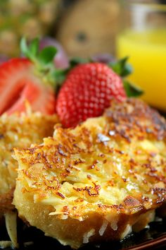 Coconut French Toast.   1 large egg  ¾ cup of coconut milk  1 tablespoon sugar  ½ teaspoon vanilla  6 slices of stale baguette  Sweetened shredded coconut  Chopped almonds  1 teaspoon butter  Maple syrup, sugar, jam (or other flavor)  fresh fruit.