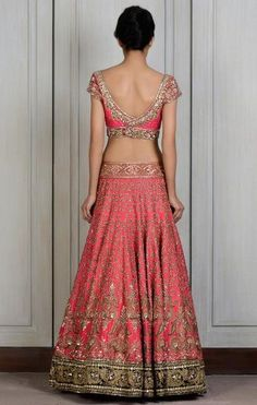This Pink raw silk lengha intricately hand-embroidered zardozi motifs all around. Densely embroidered contrasting black velvet border on the hemline. Accentuati