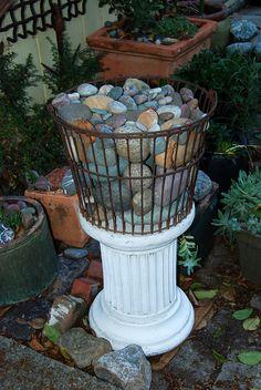 A basket of rocks as garden decor.