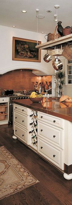 Polished copper countertop in a gorgeous kitchen designed by Kleppinger Design Group