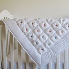 Puff Quilt  for a baby ( don't use buttons, try felt colored dots to avoid choking hazard )