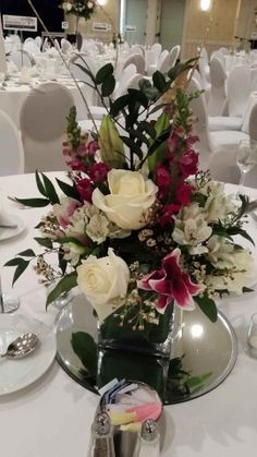 One of the centerpieces from the Virginia Union University Masquerade Ball hosted by Mayor Dwight Jones! We used the lilies, roses, and snapdragons to capture the school colors for what we know was an amazing gala! at Richmond Marriott Downtown.