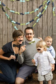 photobooth with props cut on the Silhouette machine, including the AWESOME mustache & bow tie garland