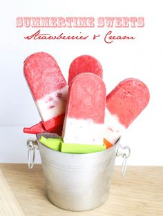 Strawberry + Greek frozen yogurt popsicles...add a layer of crushed graham crackers to the top before inserting sticks!