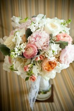 Peach pink white bridal bouquet by flower allie
